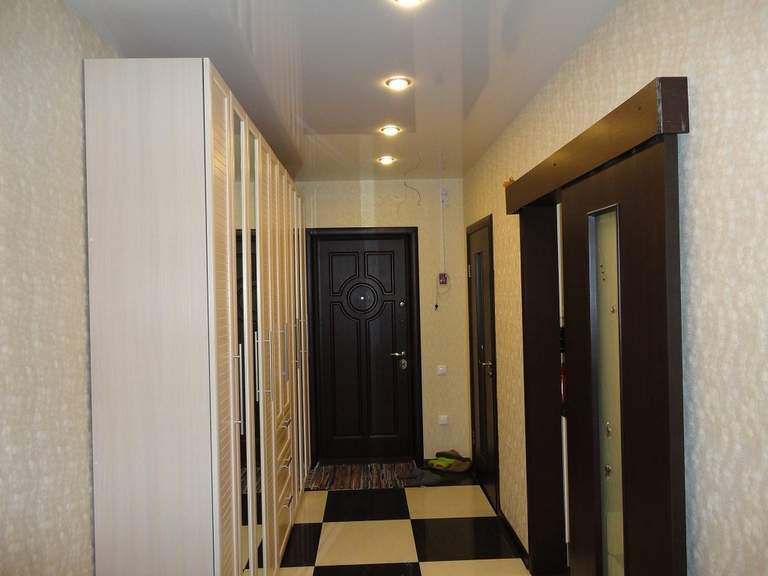 Wallpapers on the ceiling in the corridor. suspended ceiling in the